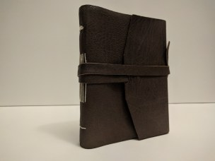 long stitch book, leather